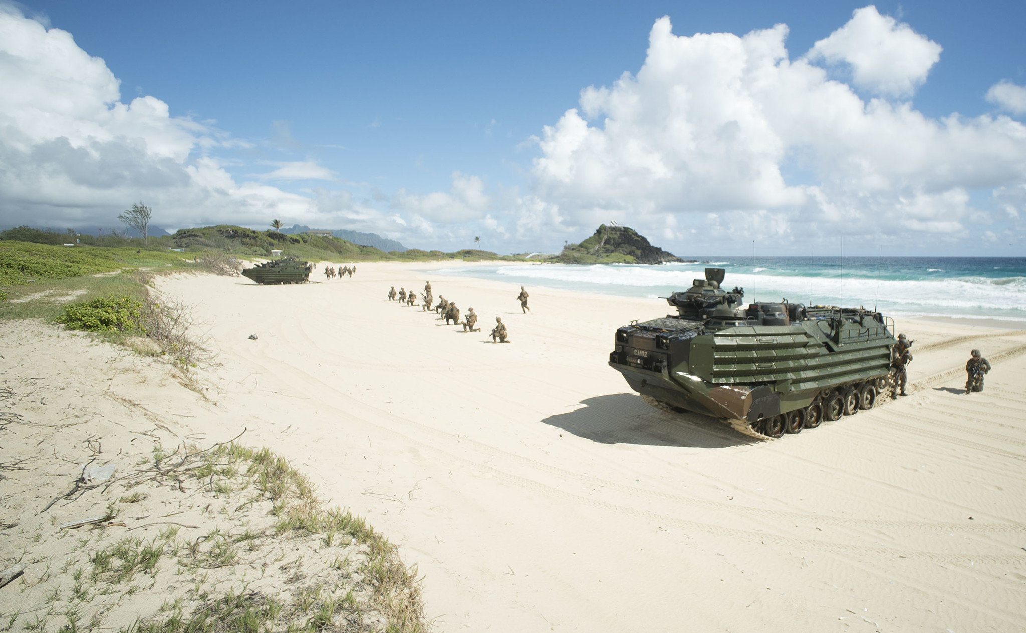 <p>Accompanied by what looked like toy soldiers, amphibious assault vehicles rolled onto the sand at Pyramid Rock Beach.</p>