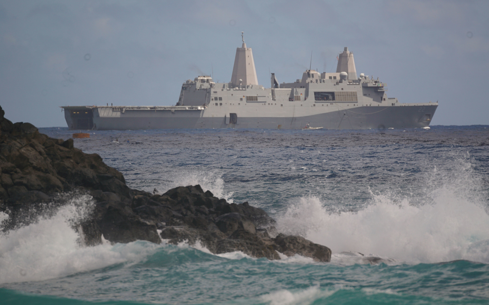 <p>The USS San Diego amphibious transport dock floats offshore Marine Corps Base Hawaii last weekend. Vesselsemerged from the ship's rear well deck to begin the assault on Pyramid Rock Beach in one of the final exercises of the 26-nation Rim of the Pacific war games.</p>