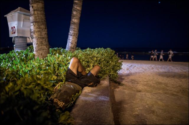 Homeless man sleep Waikiki beach desperate