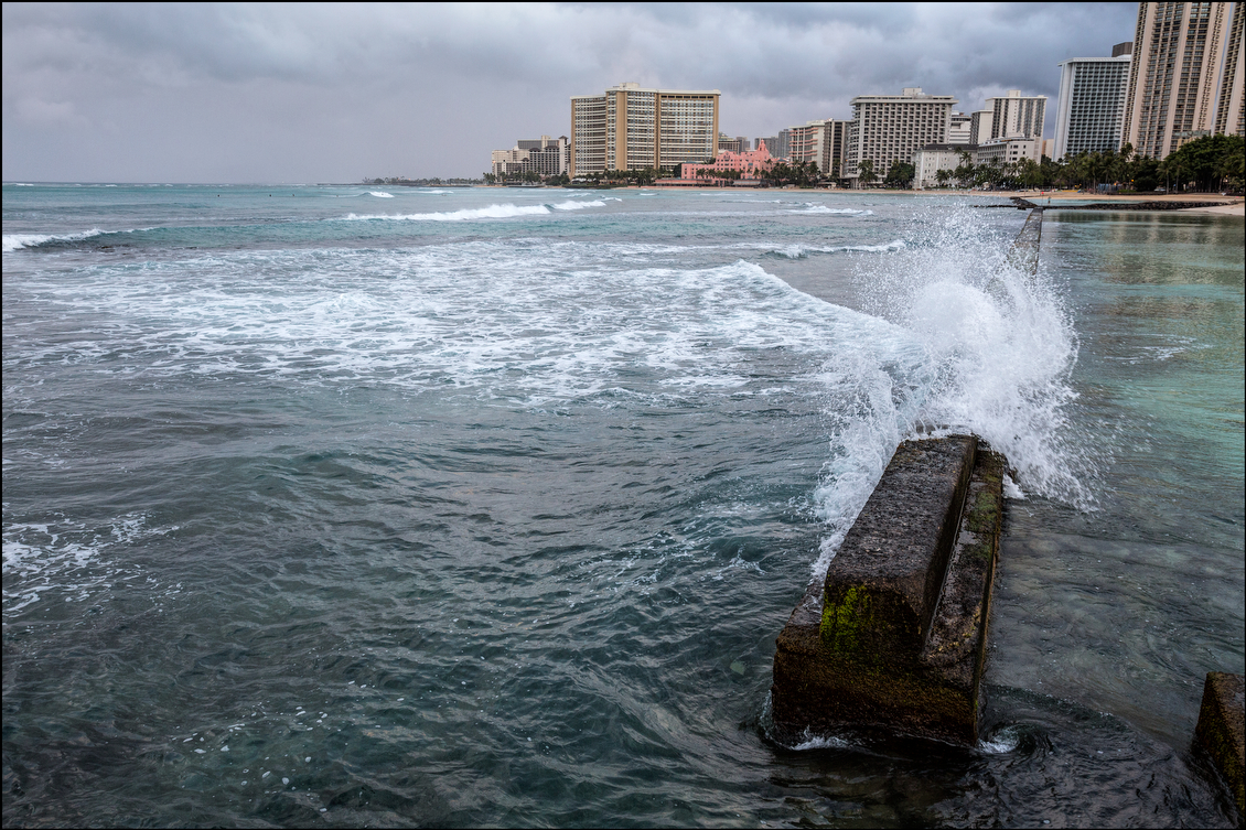 The sea wall sheltered Waikiki early in the morning on Aug. 8 as Oahu sat waiting for hurricane Iselle. The storm dumped as much as 15 inches of rain on parts of the Big Island, which took the brunt of the storm.
