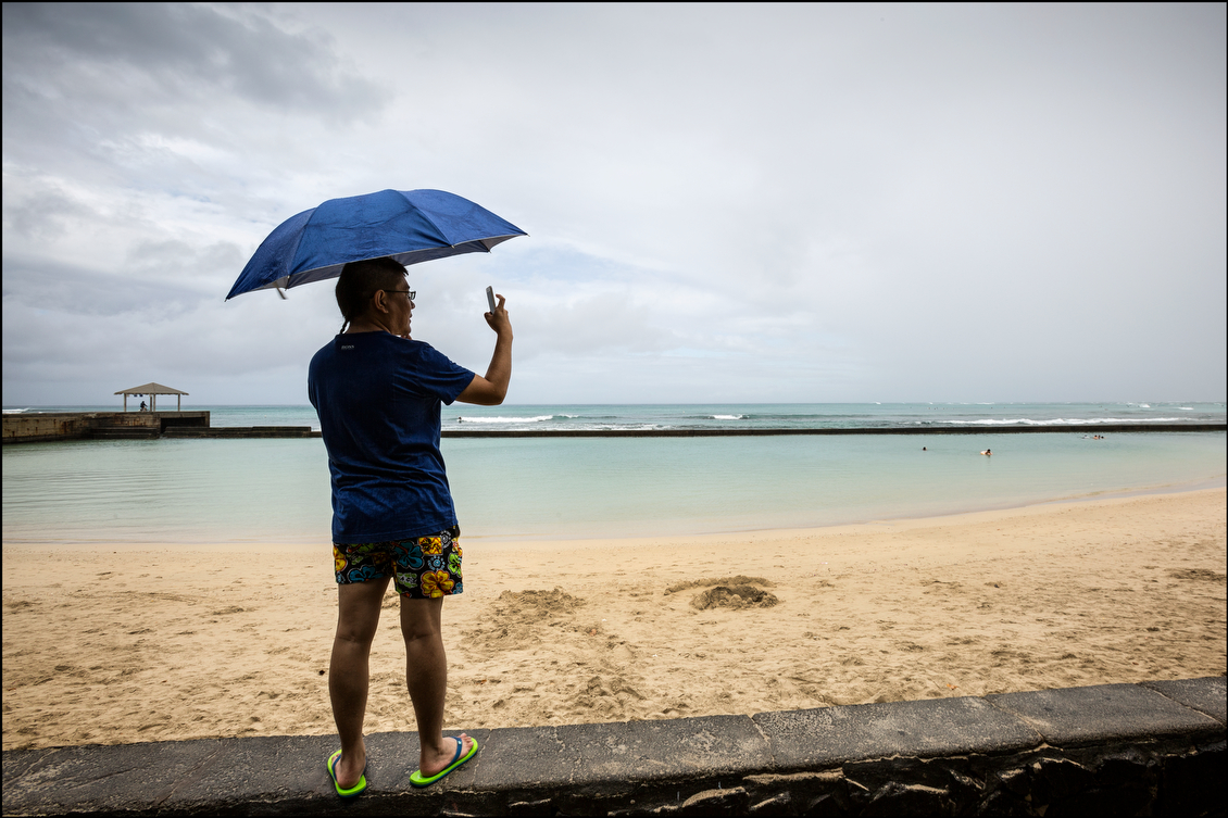 "A visitor captured a moment of calm amid the periodic gusts of wind and rain. ""This is not Kansas, this is not Florida,"" Gov. Neil Abercrombie warned at one point during the day. ""The brunt of the storm has yet to come, so I do not want anyone to misconstrue the conditions that are pretty severe."