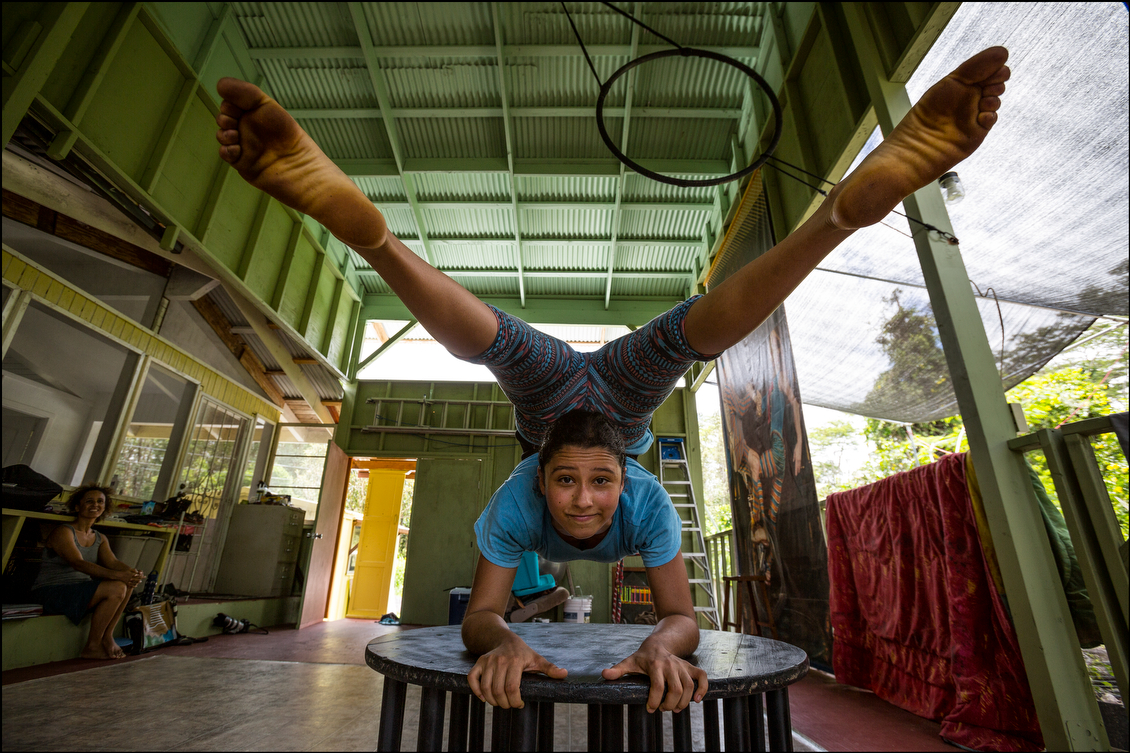 After the storm, Lucero, an athletic performance artist and trainer, got back to work with Kumsa Maphalala, 14, to sharpen the girl's contortionist routine. The girl's mother, Malakia, far left, says she sometimes has to look away when her daughter performs.