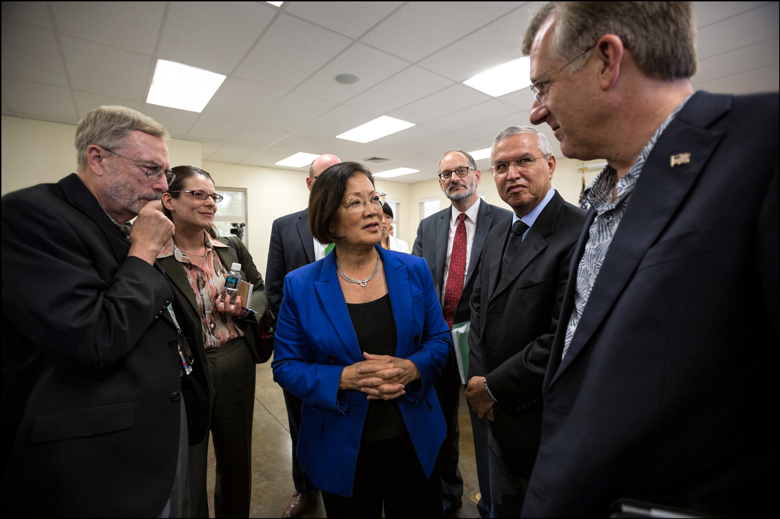 Sen. Hirono talks to VA staff following the end of the hearing after numerous veterans conveyed their strong impression that their needs are ignored by the very people whose job it is to help and care for them.