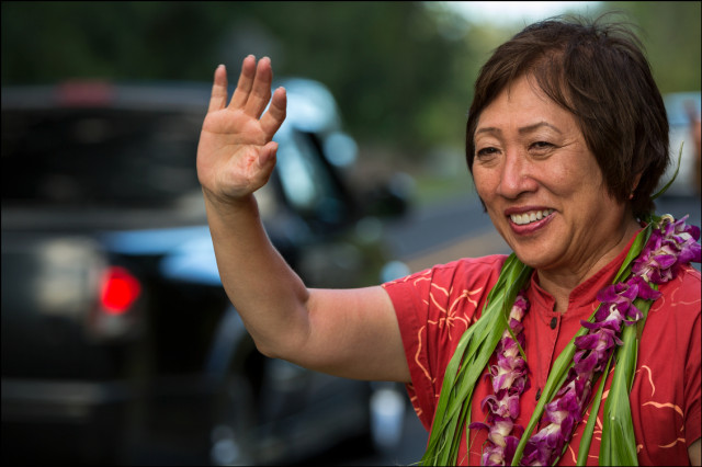 In the fading sun Rep. Colleen Hanabusa gets in her last sign waving session in Puna close to the 6pm closure of the polls on August 15, 2014.