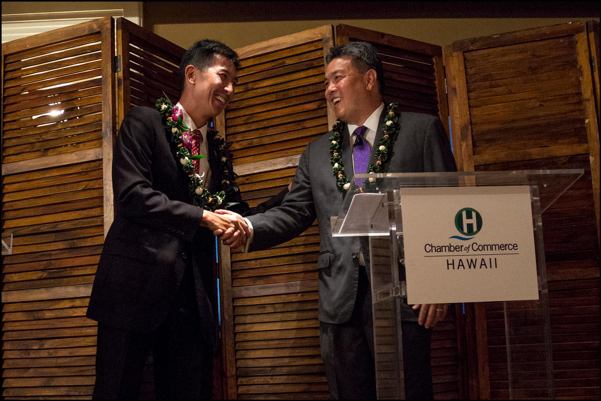 <p><strong>September 2014, General Election Campaign:</strong> Republican candidate Charles Djou and Takai shake hands at end of a congressional candidates forum. (Civil Beat photo by PF Bentley)</p>