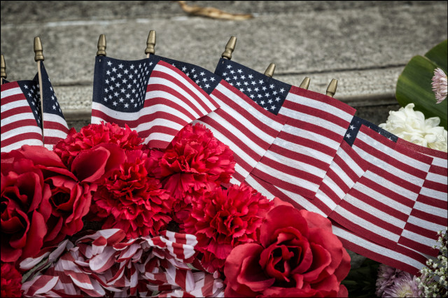 US Flags on floral arrangement at the Hawaii State Veteran's Cemetery in Kaneohe on October 2, 2014