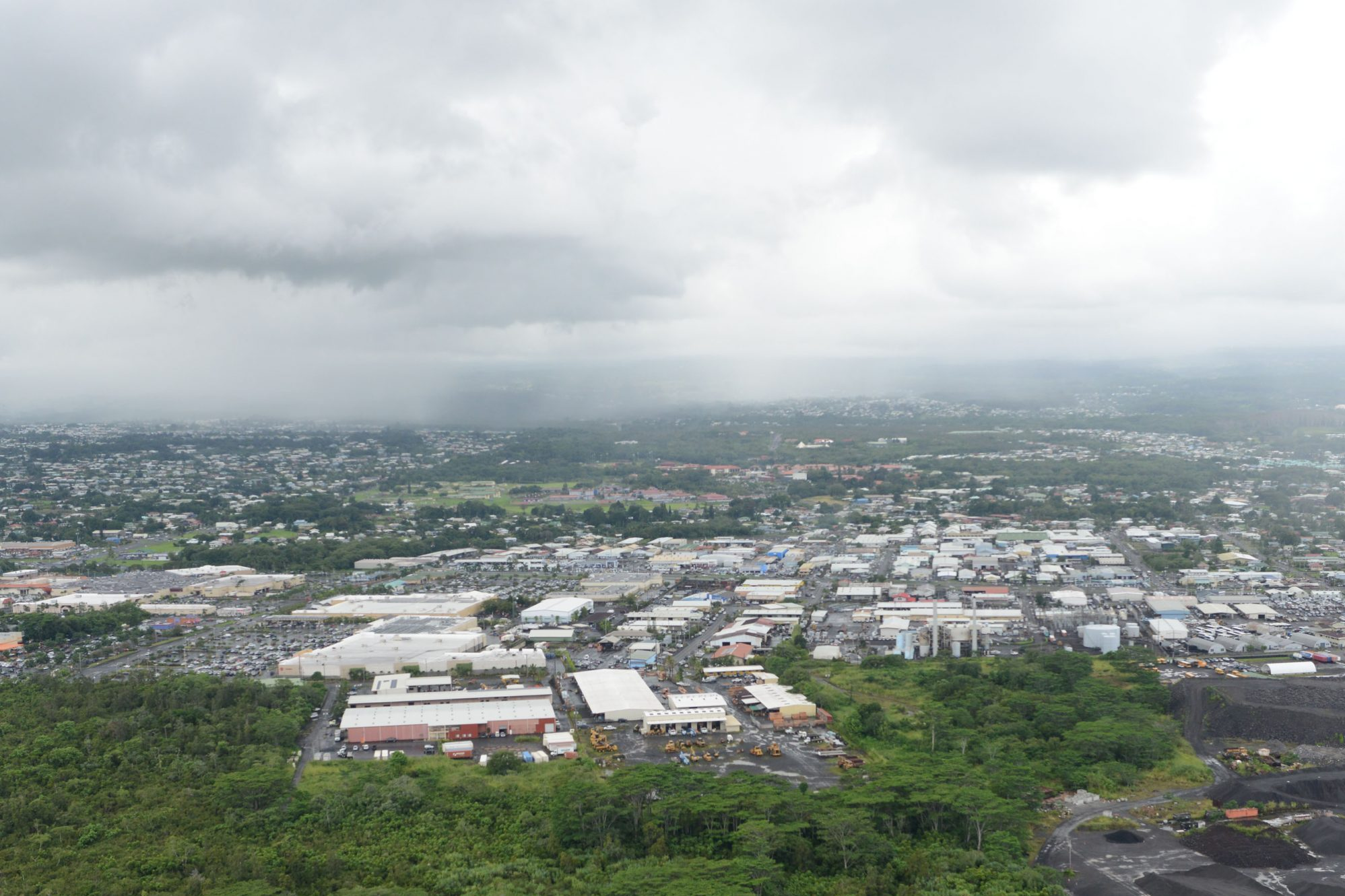View looking north from the airport as helicopter was flying east out of the airport. Industrial area of Hilo, Hawaii near Airport. Hilo, Hawaii. 29 october 2014. photograph Cory Lum