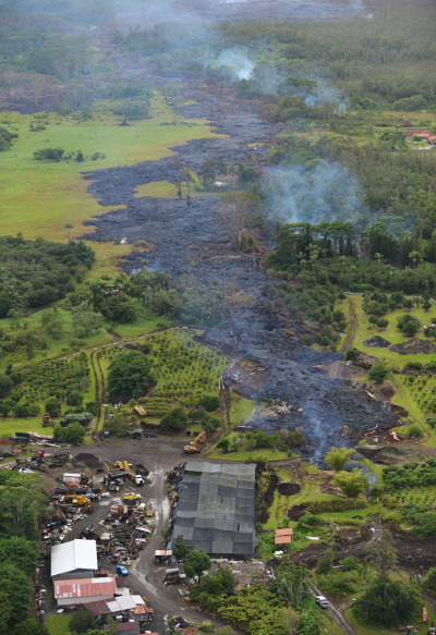 Lava approaches Pahoa Road, bottom frame in this file image from October 29, 2014. Pahoa, Hawaii. Photograph Cory Lum