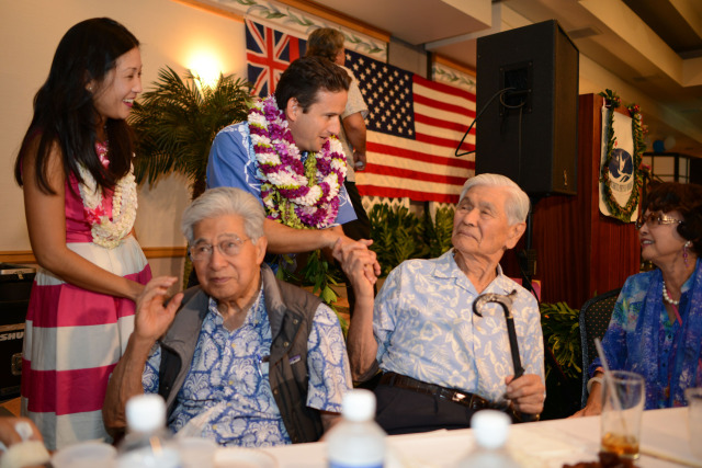 US Senator Brian Schatz and wife Linda Kwok Schatz greet Governor George Ariyoshi while second from left, Senator Daniel Akaka looks on,  after speaking at the Democratic Party of Hawaii's Democratic Coordinated Election Night Celebration held at the Japanese Cultural Center of Hawaii.  4 November 2014. photograph by Cory Lum