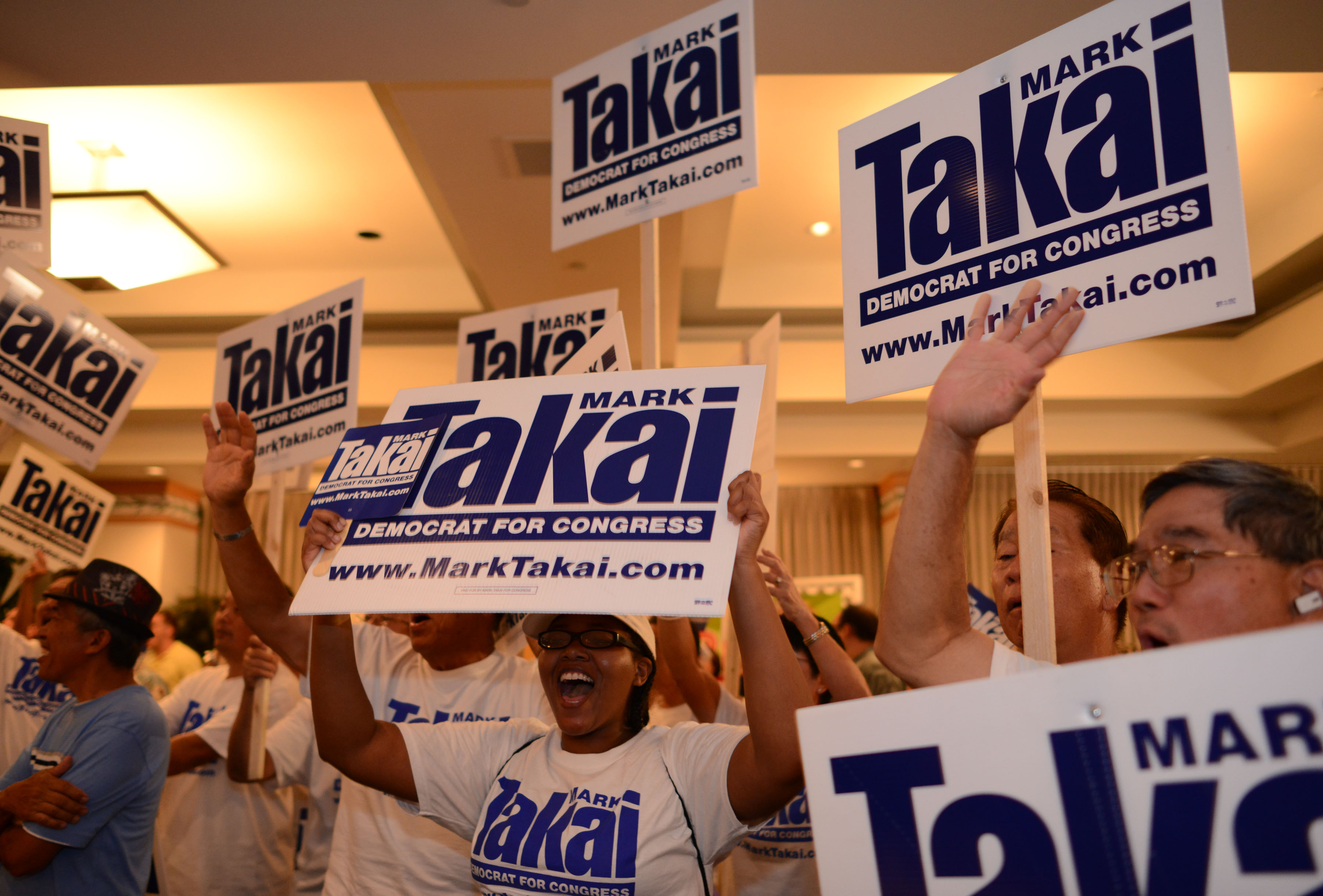 <p><strong>November 2014, Election Night:</strong> Takai's supporters cheer early returns showing him ahead in the race for Congress.</p>