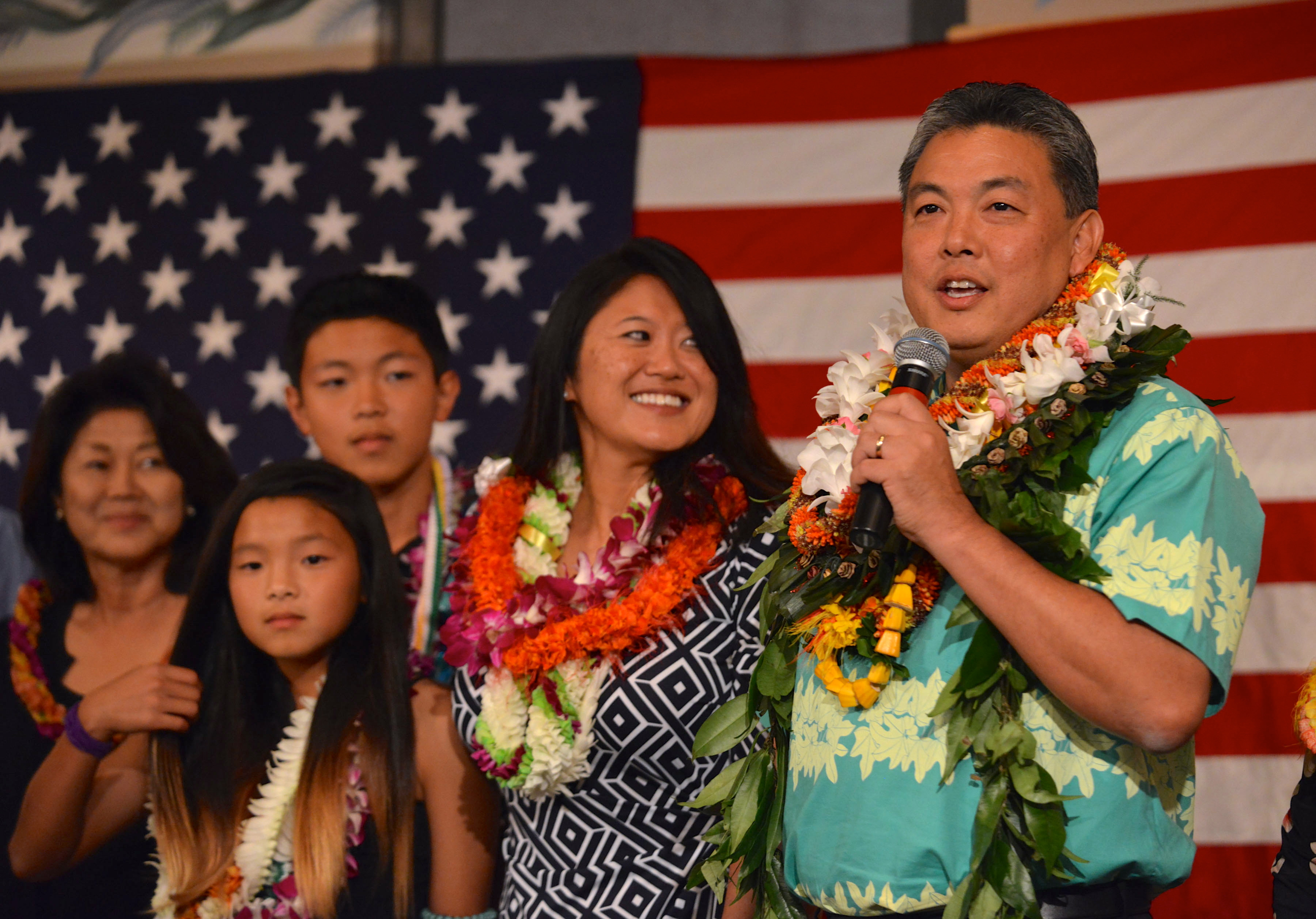 <p><strong>November 2014, Victory Speech:</strong> Takai speaks to his supporters after being declared the winner. He's joined by his wife, Sami, son Matthew and daughter Kaila.</p>