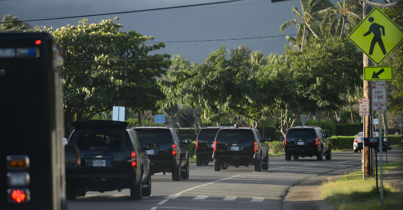 <p>Morning workouts in Kaneohe at Marine Corps Base Hawaii are part of the president&#8217;s routine. After a visit in December 2013, his motorcade cruises back toward his vacation rental in Kailua.</p>
