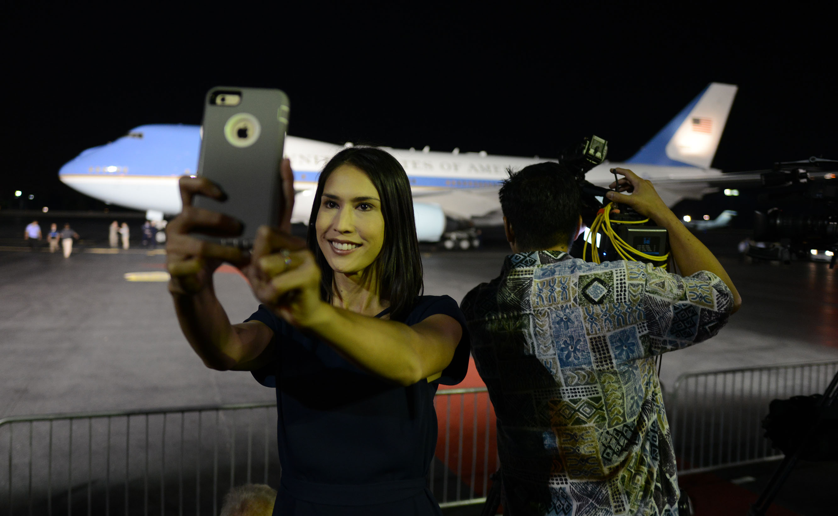 <p>Members of the local media on hand for presidentialarrivals and/or departures sometimes shoot selfies during their down time. KHON reporter Sarah Yoro captures herself with Air Force One in the background on Dec. 19, 2014.</p>