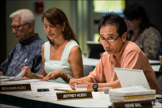 UH Board of Regents member Benjamin Kudo speaks for delaying the vote for UH President during regents meeting.Kudo abstained from voting.