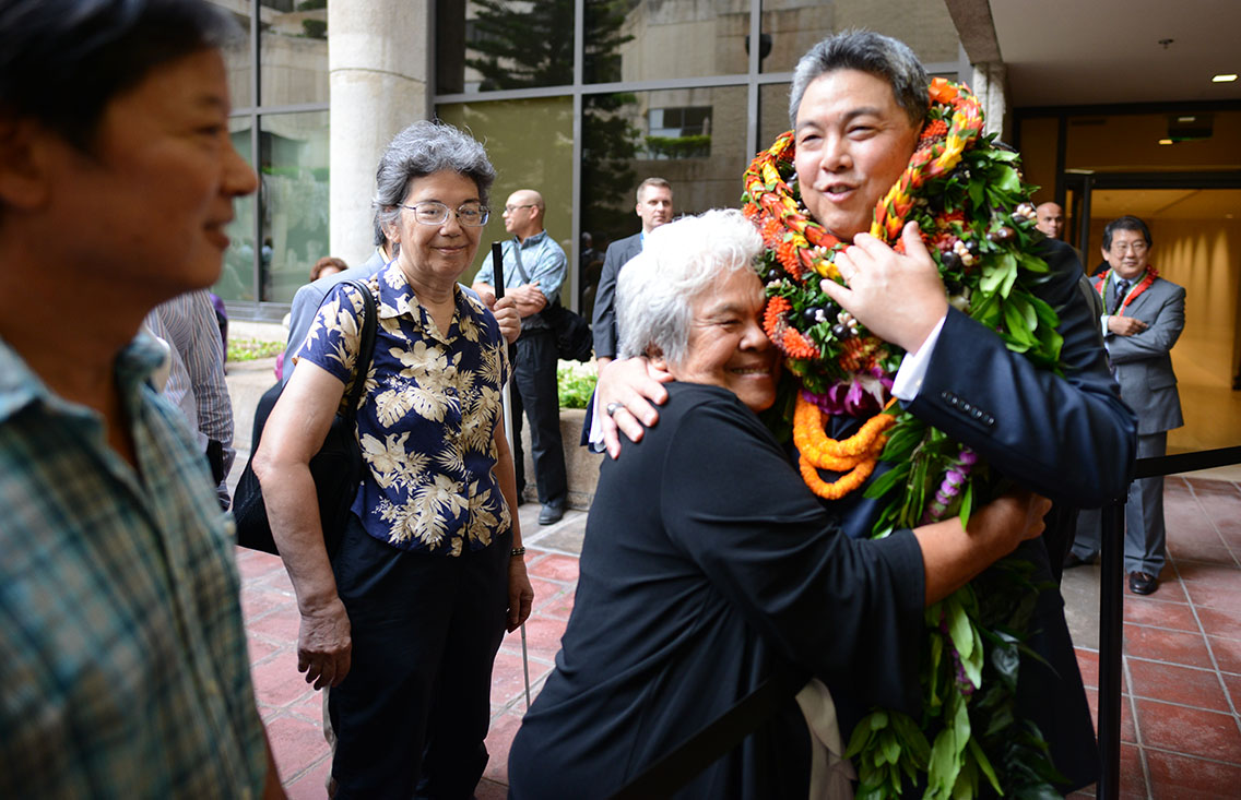 <p><strong>January 2015, Island Support:</strong> Kona resident Shirley Kauhaihao hugs Takai after the oath of office ceremony.</p>