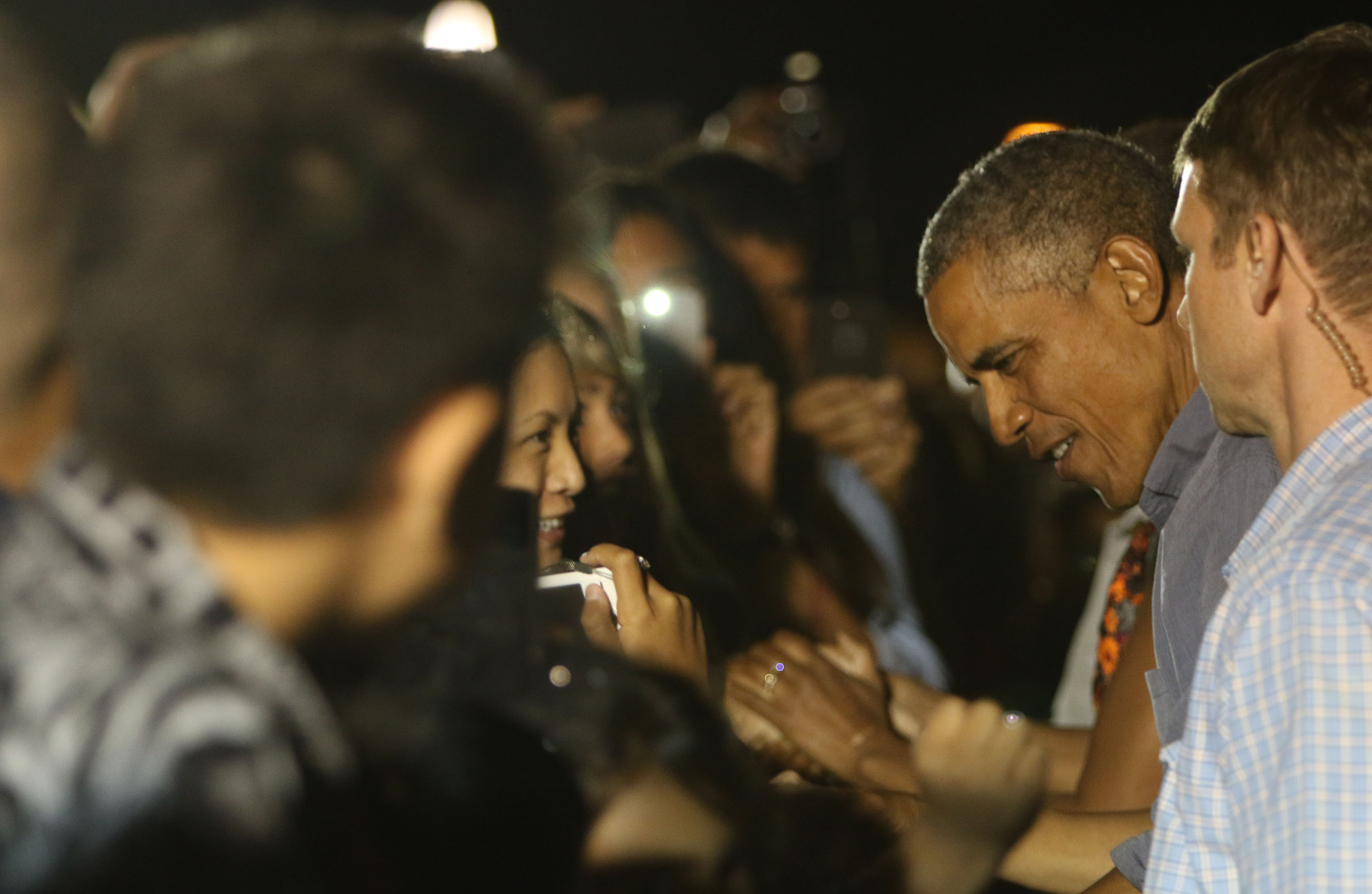 <p>Each vacation ends with a motorcade drive back to Joint Base Pearl Harbor-Hickam. The president greets well-wishers at the base Jan. 3, 2015.</p>