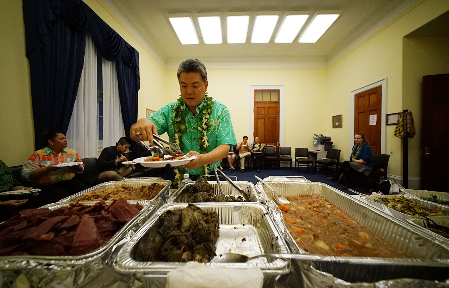 "<p><strong>February 2015, Taste of Home:</strong> Takai loads up his plate at an ""Aloha Friday"" celebration in the Cannon House Office Building in Washington.</p>"