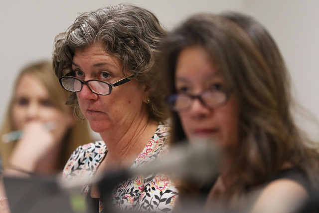 Left, Senator Laura Thielen and Senator Suzanne Chun Oakland listen to testimony during education and  Health committee meeting, Capitol Room 229.  4 feb 2015. photograph Cory Lum/Civil Beat