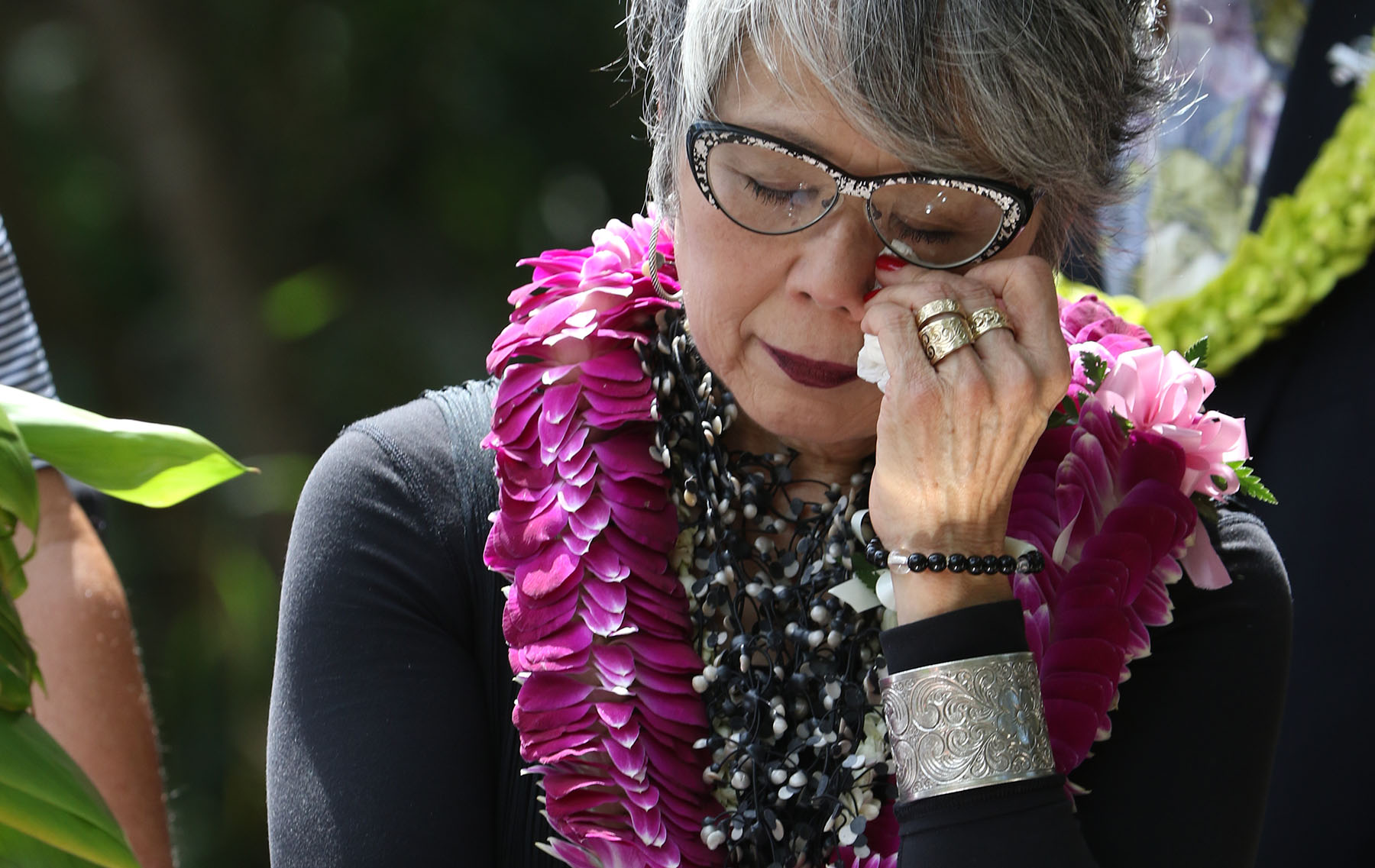 <p>In late March, a ceremony was held to dedicate the Honouliuli National Monument at the site where 400 civilians were incarcerated alongside prisoners of war during World II. The civilians were some of the 120,000 Japanese-Americans sent to internment camps nationwide. Carole Hayashino, executive director of the Japanese Cultural Center of Hawaii, listens to U.S. Secretary of the Interior Sally Jewell speak.</p> <p> </p>