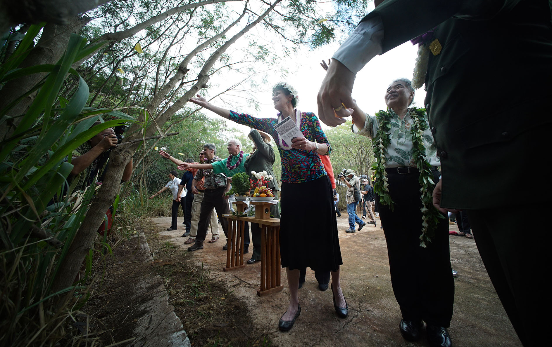 <p>U.S. Secretary of the Interior Sally Jewell and Gov. David Ige throw rose petals at the close of the Honouliuli National Monument dedication ceremony.</p>