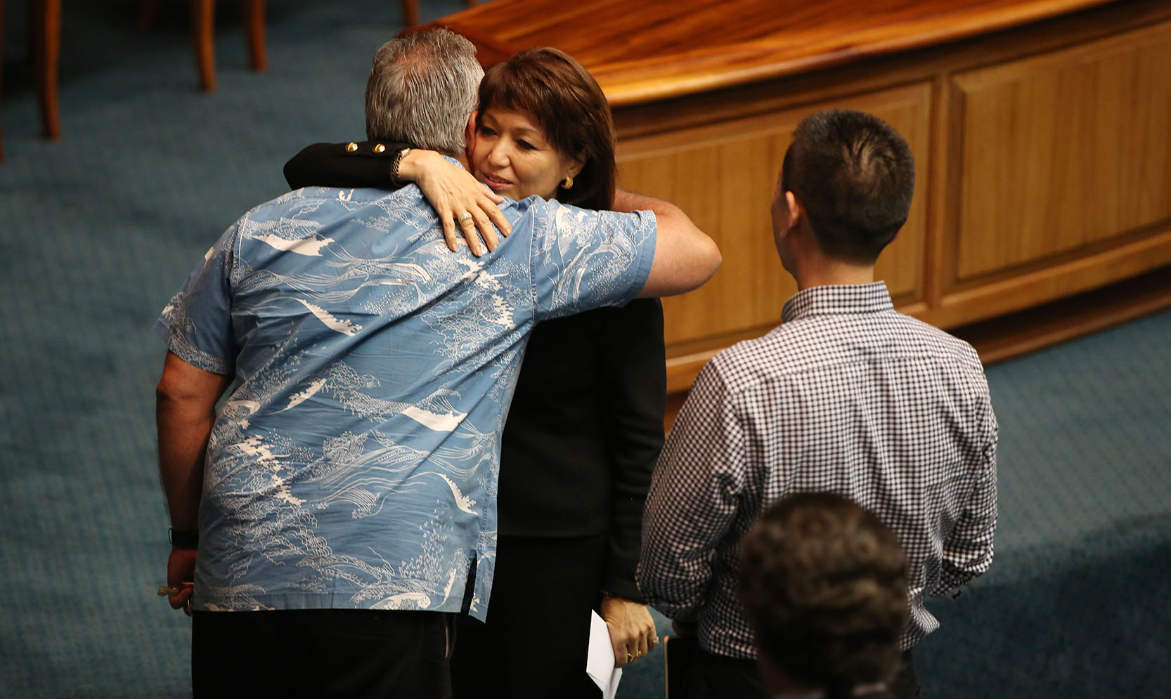 <p>Senate President Donna Mercado Kim hugs Ige's chief of staff, Mike McCartney, after he delivers a letter on the Senate floor withdrawing the nomination of Ching. Ige pushed hard for Ching, but gave up when it became apparent there weren't enough votes of support in the Legislature. In November, Ching was named director of land development for the University of Hawaii.</p>