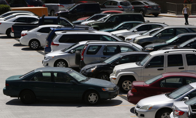 Quite a few cars were reverse parked at Ala Moana Shopping Center top deck.  10 march 2015. photograph Cory Lum/Civil Beat