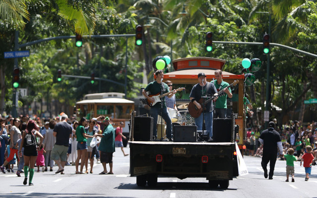 Visitors and residents enjoy live music along Kalakaua Avenue during the annual Saint Patrick's parade held from Fort DeRussy to Kapiolani Park. 17 march 2015. photograph Cory Lum/Civil Beat