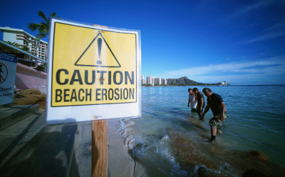 Small waves thrash the beach and sand in Waikiki. Honolulu. Hawaii. 2 march 2015. photograph cory Lum/Civil Beat