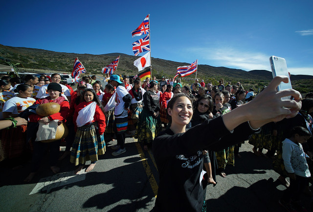 Supporters gather on the road fronting the Mauna Kea visitor center. 10 april 2015. photograph Cory Lum/Civil Beat