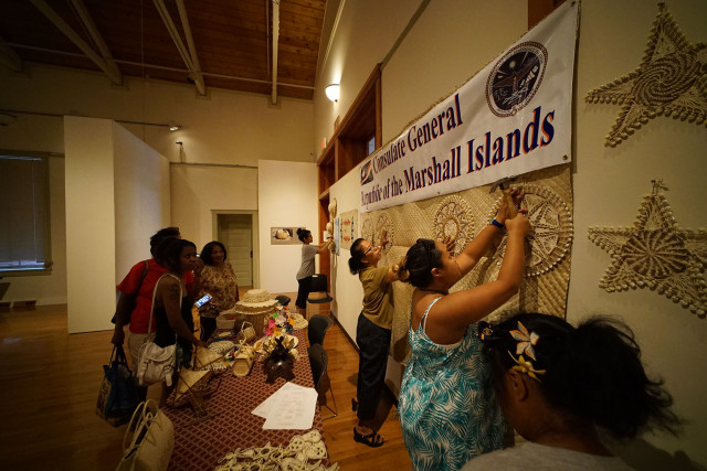 Volunteers set up craft displays at the Celebrate Micronesia at the Honolulu Museum of Art School. 28 march 2015. photograph Cory Lum/Civil Beat