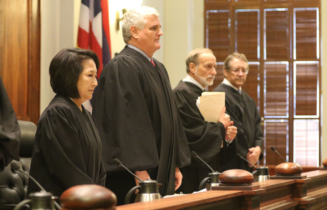 Left, Associate Justice Paula Nakayama, Chief Justice Mark Recktenwald, Associate Justice Richard Pollack stand as justices enter the courtroom. 18 june 2015. photograph Cory Lum/Civil Beat