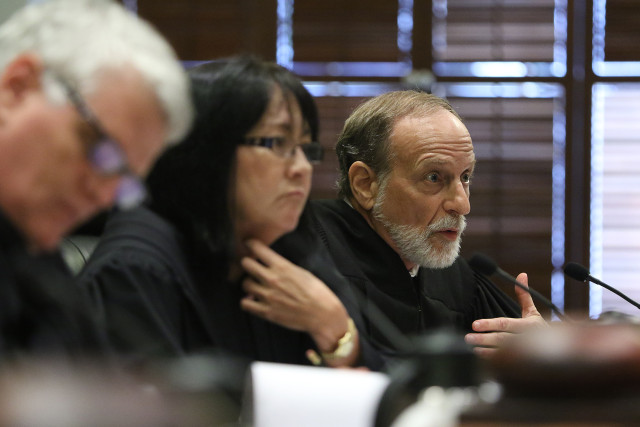 Hawaii Supreme Court Associate justice Richard Pollack questions attorneys during Hawaii State Supreme Court oral arguments from The Sierra Club vs. DR Horton-Schuler Homes, The Land Use commission, Office of Planning and Dept of Planning and Permitting . 25 june 2015. photograph Cory Lum/Civil Beat