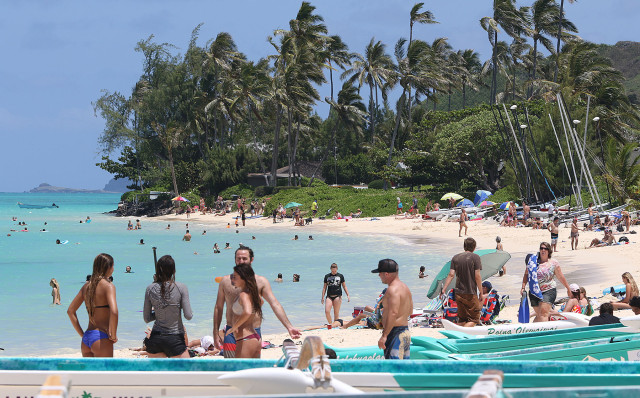 Shores of Lanikai Beach with visitors enjoying the azure blue waters and powdered sand. 2 june 2015. photograph Cory Lum/Civil Beat