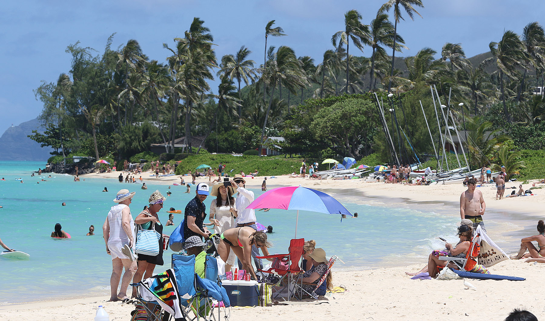 Visitors enjoy Lanikai Beach. LANIKAI TRAFFIC. 2 june 2015. photograph Cory Lum/Civil Beat
