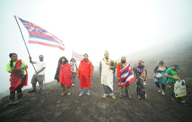 Mauna Kea supporters chant along the summit access road.  24 june 2015. photograph Cory LUm