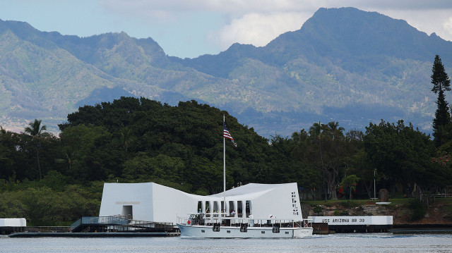 Visitors arrive via boat to the USS Arizona Memorial with a clear view of the Waianae Mountain range as a backdrop. 5 june 2015. photograph Cory Lum/Civil Beat