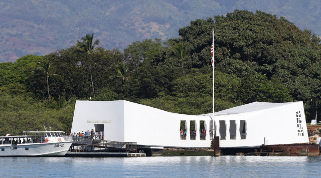 Visitors arrive onboard the USS Arizona Memorial with a clear view of the Waianae Mountain range as a backdrop. 5 june 2015. photograph Cory Lum/Civil Beat