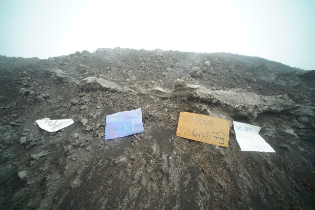 Mauna Kea supporters leave their signs along access road after DLNR officers and TMT workers turn around. 25 june 2015. photograph Cory Lum/Civil Beat