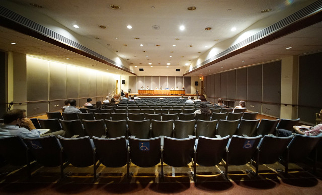 Wide view of the Capitol Auditorium of sparsely attended Panel 1 of the Hawaii Advisory Committee to US Commission on Civil Rights, public meeting on Micronesian immigration issues. 20 aug 2015. photograph by Cory Lum/Civil Beat