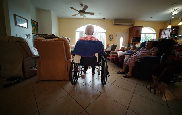 Residents at Hokulaki Senior Living LLC gather in the living room to sing karaoke. 14 aug 2015. photograph Cory Lum/Civil Beat