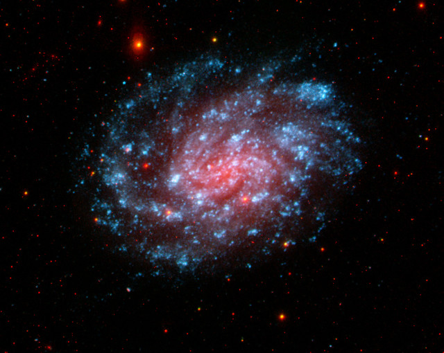 NGC_300_in_Ultraviolet_and_Visible