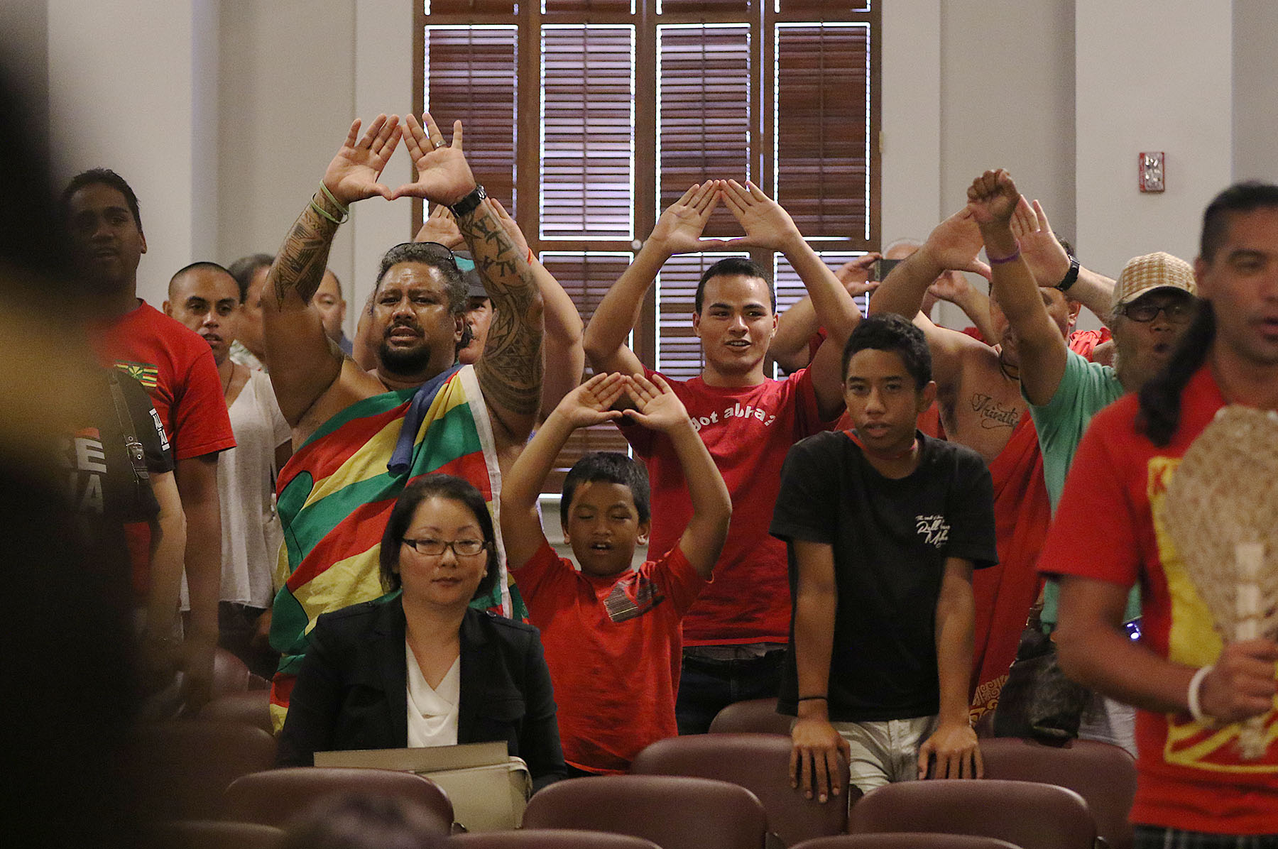 <p>Thirty Meter Telescope opponents sing after attorneys present oral arguments at the Hawaii Supreme Court in late August regarding whether the state acted properly in approving a construction permit in 2011 before conducting a contested case hearing. In December the high court invalidates the permit, meaning TMT officials must seek a new one if they still want to build the telescope.</p>