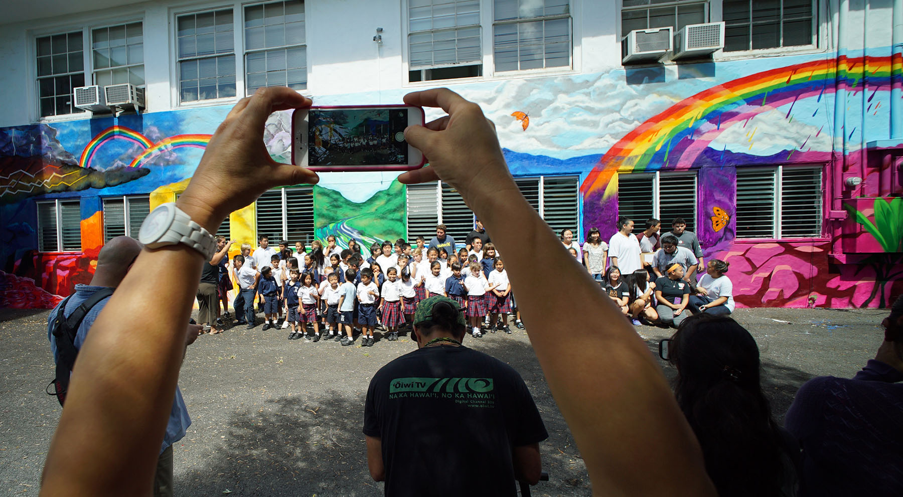 <p>A ceremony unfolds Monday at Cathedral Catholic Academy on Nuuanu Avenue. Its students partnered with others from the Pacific Buddhist Academy and the Mele Murals program to design and paint a mural.</p>