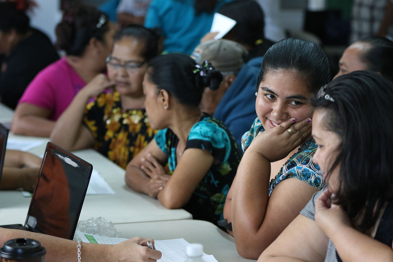 <p>Dakleen Salla from Chuuk, left, successfully enrolled in the Hawaii Health Connector at the St. Elizabeth's recruitment drive.</p>