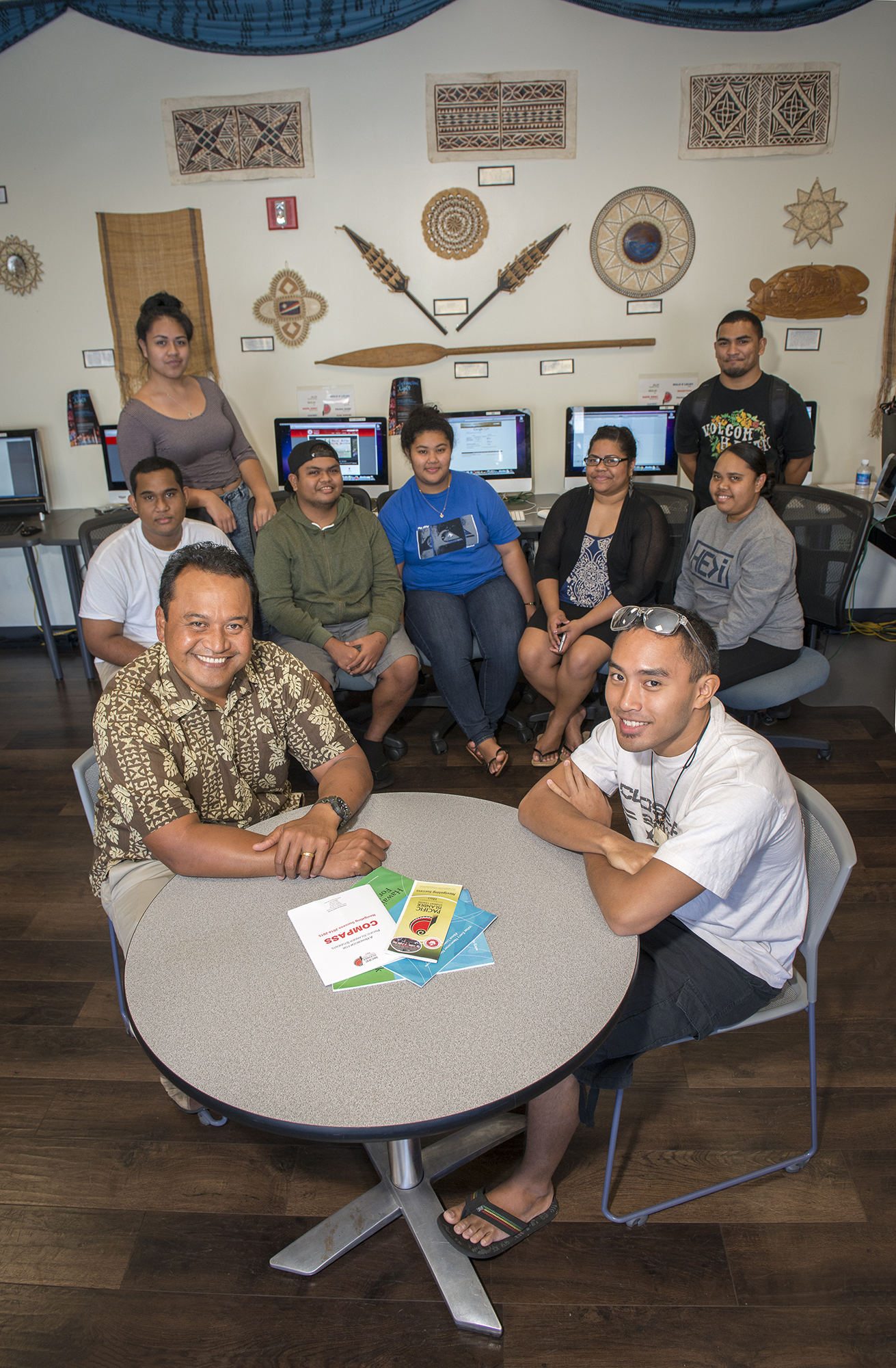 <p>Vidalino Raatior, left, with Micronesian students and staff at thePacific Islander Student Center at UH Hilo. Raatior runs the student center and is determined to help fellow Micronesians settle successfully in Hawaii.</p>