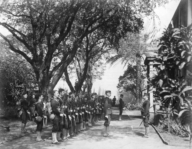 The USS Boston's landing force on duty at the Arlington Hotel in Honolulu at the time of the overthrow of the Hawaiian monarchy, January 1893. This was the site of the childhood home of Queen Liliuokalani.