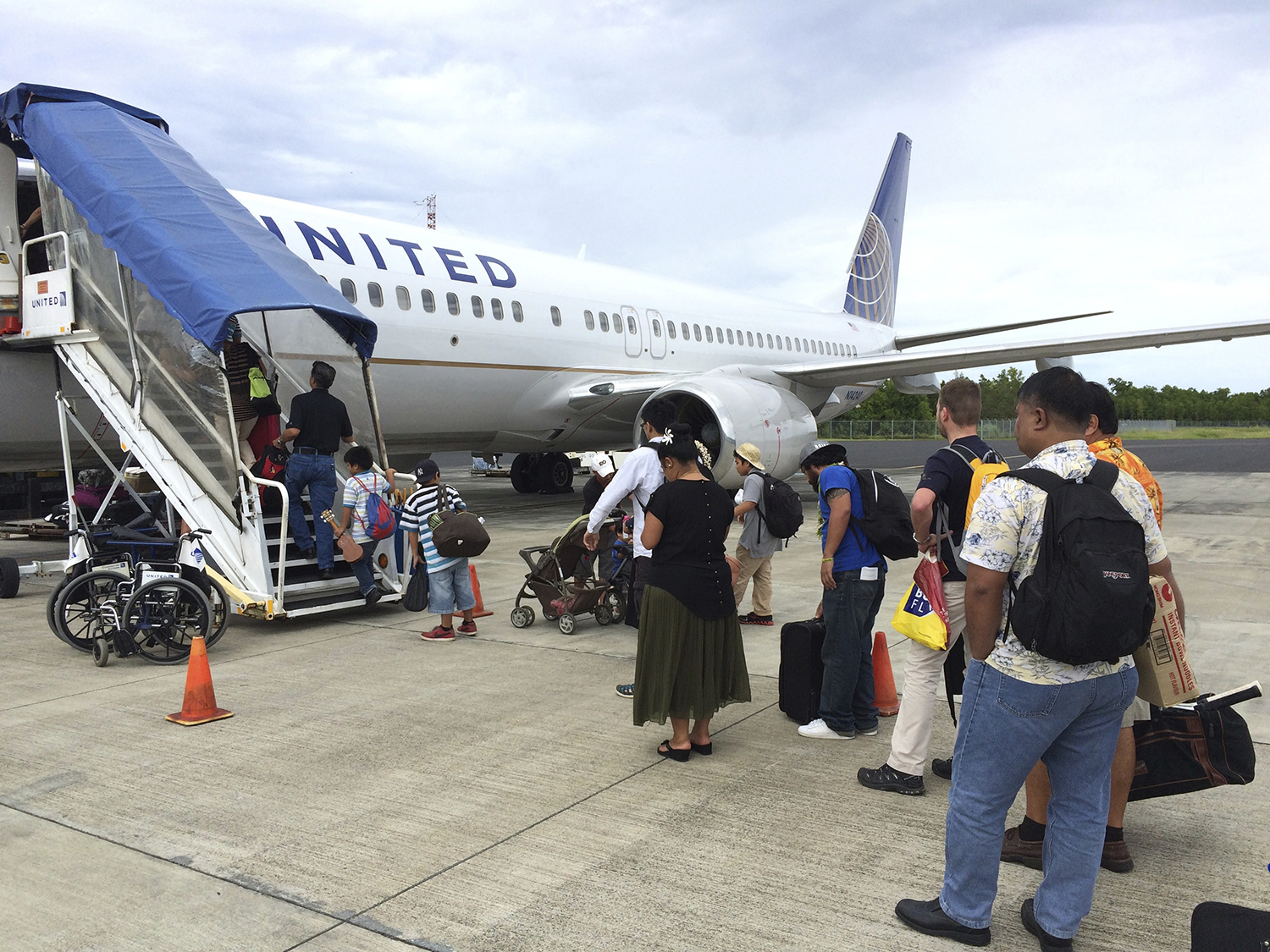 <p>United Airlines is the only commercial passenger service to much of Micronesia. Here, passengers board a flight at the international airport in Chuuk.</p>