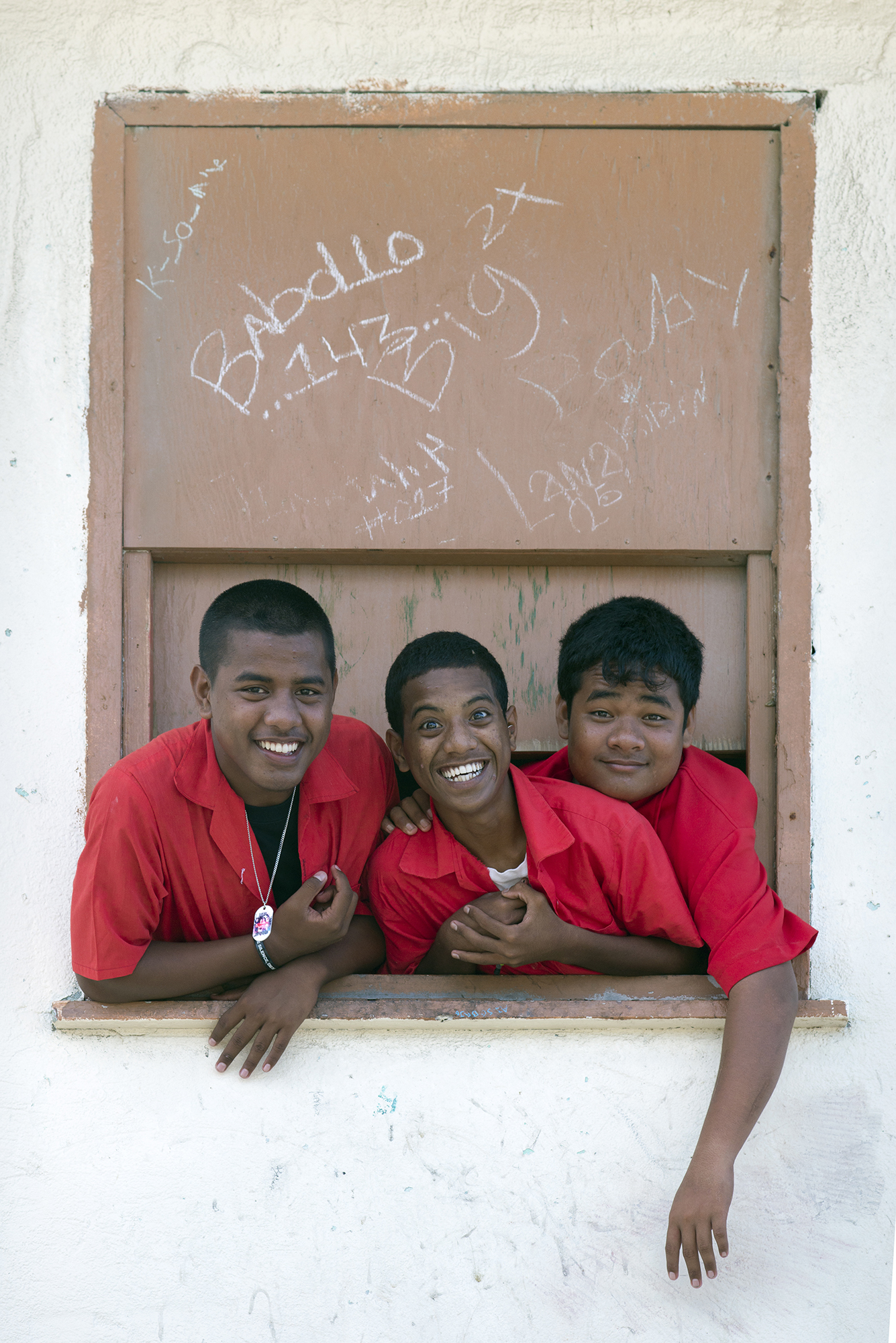 <p>Most schools require uniforms, and these boys on Ebeye are no exception. Photo by Mark Edward Harris.</p>