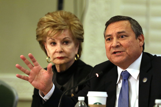 Guam Gov. Eddie Calvo gestures while Congresswoman Madeleine Bordallo looks on.