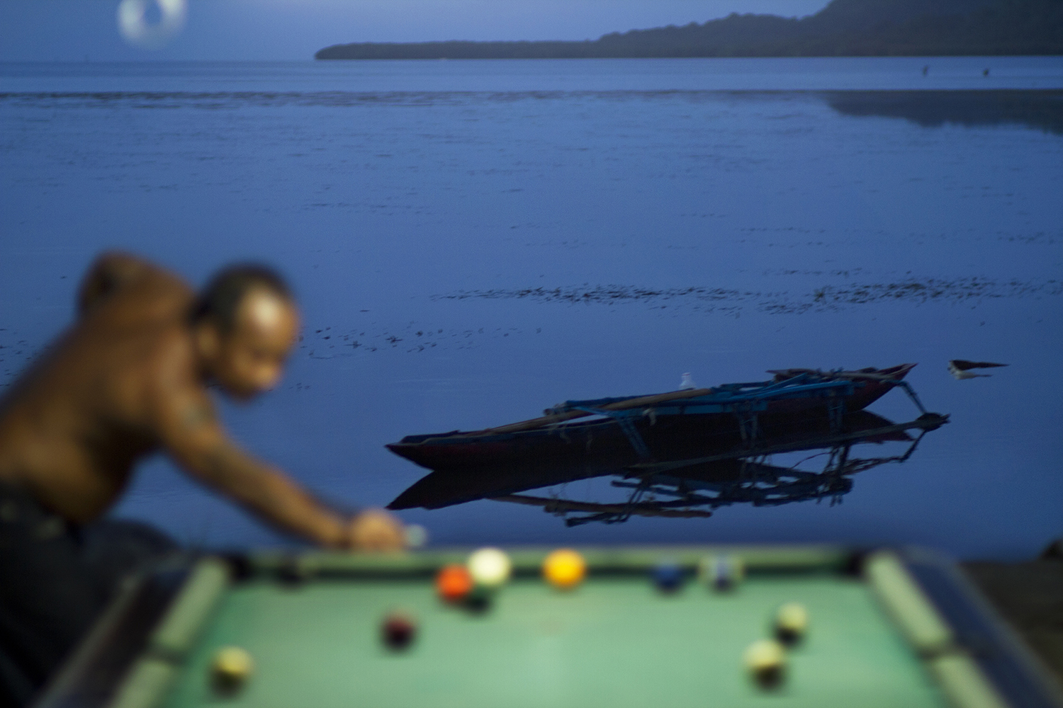 <p>Shooting pool at a house on the water in Nett.</p>